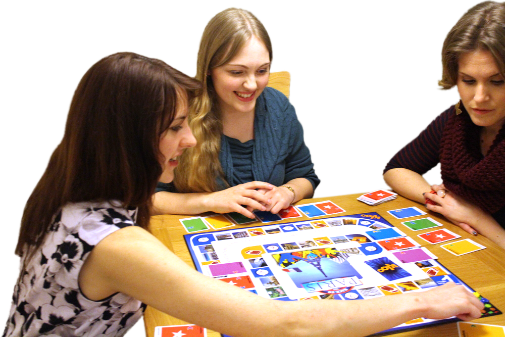 Adults playing board game to learn French
